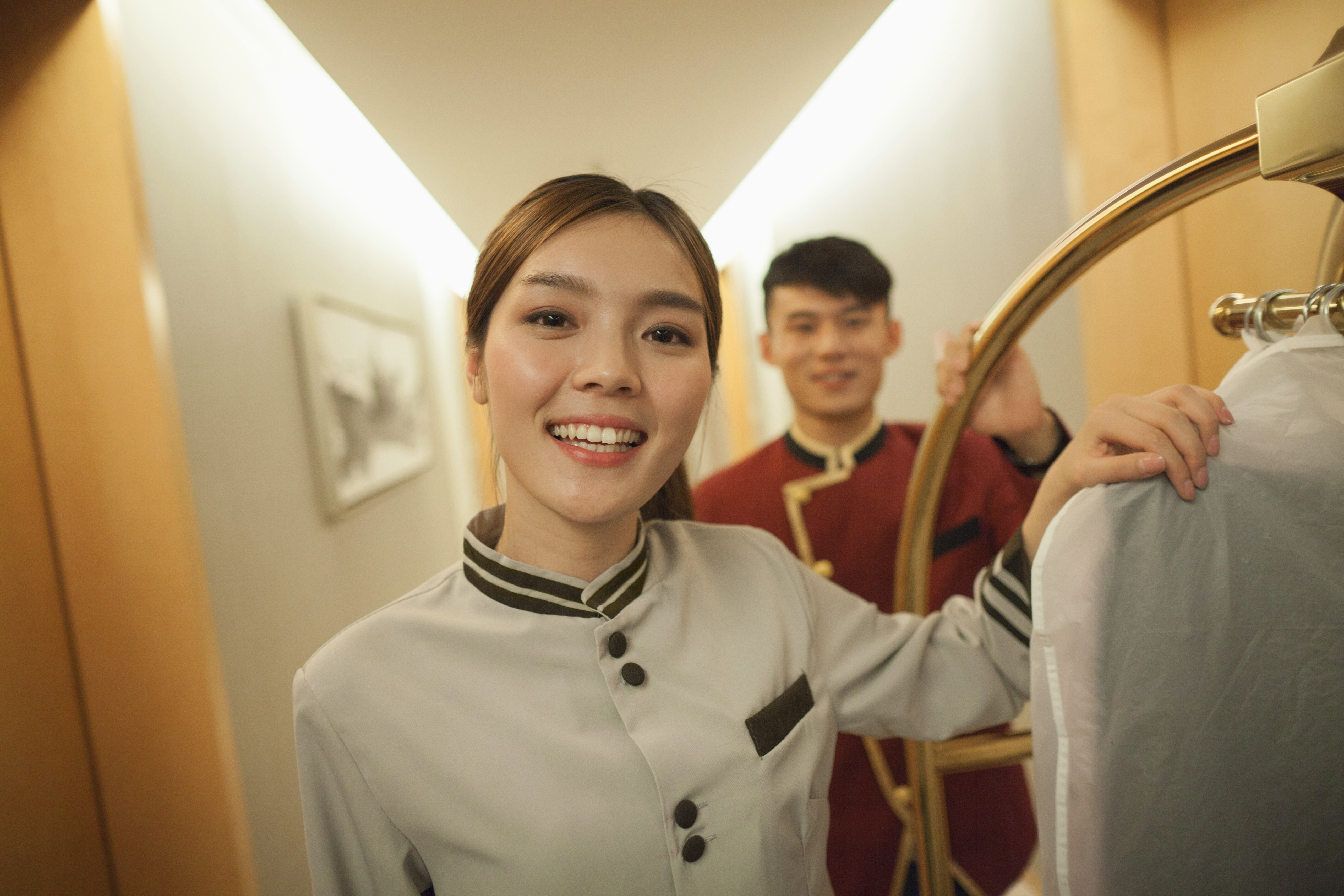 bigstock-Bellhops-in-the-doorway-smilin-50560568